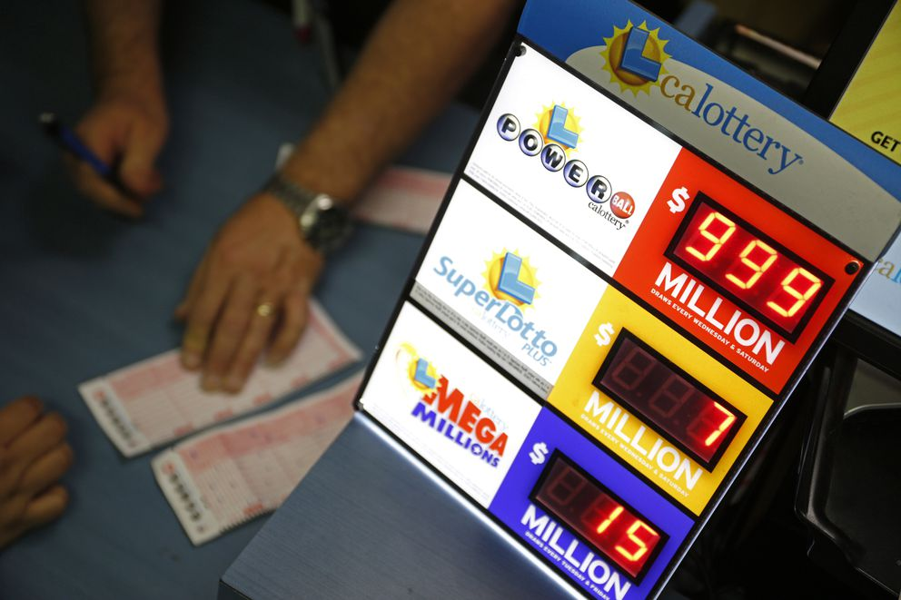 People buy lottery tickets at the Primm Valley Casino Resorts Lotto Store just inside the California border Tuesday, Jan. 12, 2016, near Primm, Nevada. (AP Photo/John Locher)