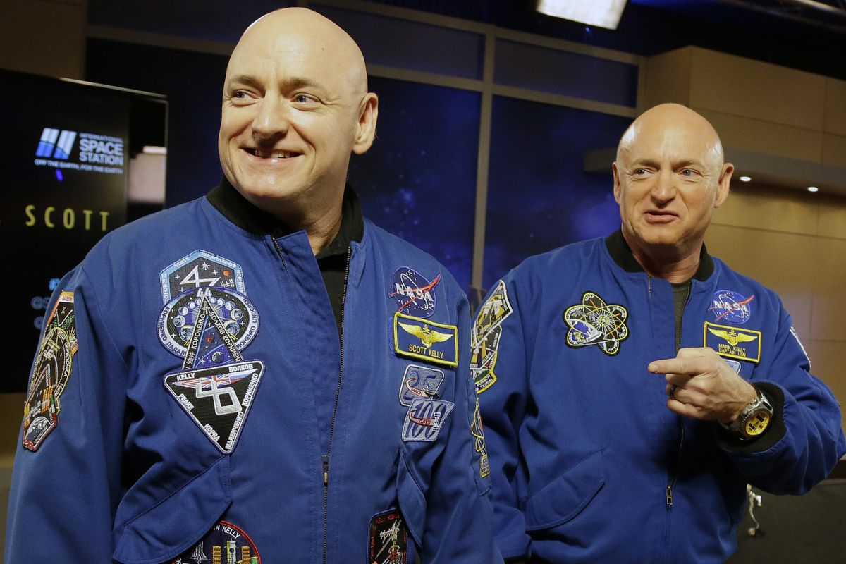 NASA astronaut Scott Kelly, left, and his identical twin, Mark, before a news conference in Houston in 2016. From his eyes to his immune system, Scott's body sometimes reacted strangely to nearly a year in orbit, at least compared to his Earth-bound brother -- but research published on Thursday, April 11, 2019 shows nothing that would cancel even longer space treks, like to Mars. (AP Photo/Pat Sullivan, File)