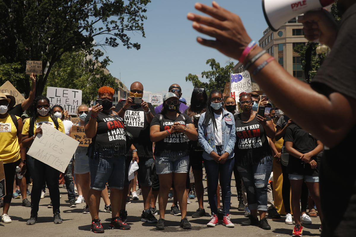 Demonstrators protest Sunday, June 7, 2020, near the White House in Washington, over the death of George Floyd, a black man who was in police custody in Minneapolis. Floyd died after being restrained by Minneapolis police officers on Memorial Day. (AP Photo/Maya Alleruzzo)