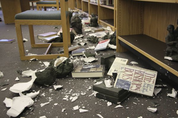 Damage is shown to the library at Chugiak High School in Chugiak, Alaska, following earthquakes Friday, Nov. 30, 2018. Acting Principal Allison Susel said ceiling tiles came down, books and other items were thrown off shelves in the library and there was water damage, but there were no injuries to students or staff at the suburban Anchorage school. (AP Photo/Mark Thiessen)