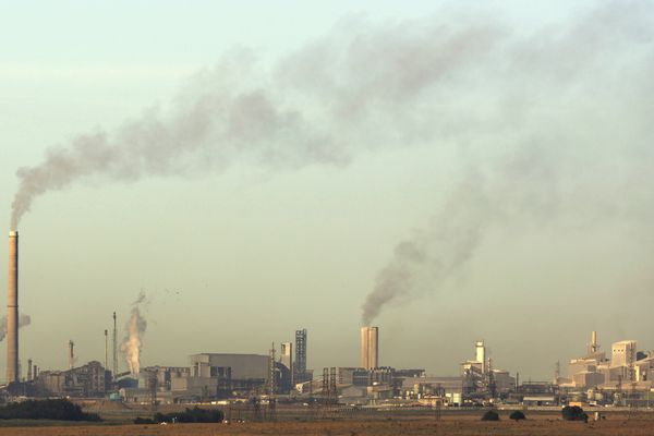 Smoke billows from the chimneys at Sasol Plant, a plant that produces petrol and diesel from coal, in Sasolburg, South Africa, Tuesday, Dec. 4, 2018. The two-week U.N. climate meeting in Poland is intended to finalize details of the 2015 Paris accord on keeping average global temperature increases well below 2 degrees Celsius (3.6 Fahrenheit). (AP Photo/Themba Hadebe)