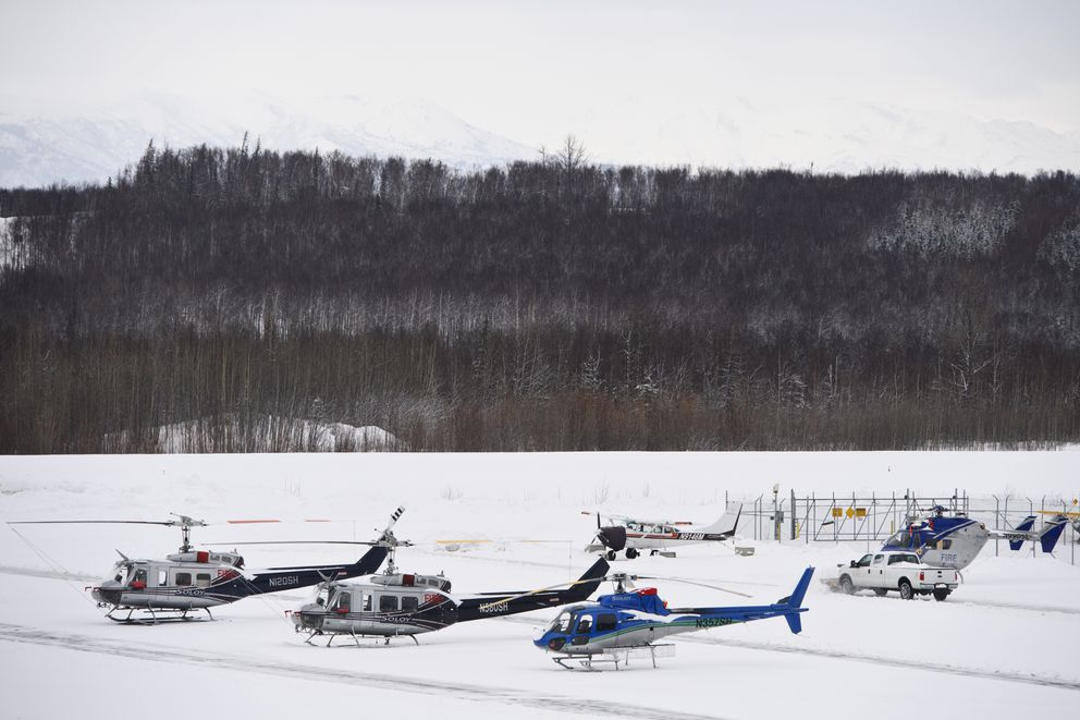 Helicopters are parked near the Soloy Helicopters headquarters at Wasilla Airport on Monday, March 29, 2021 (Marc Lester / ADN)