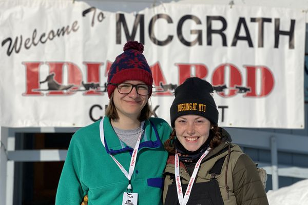 Griffing Ferrell, 20, from left, and Katy Gehrke, 19, photographed on Wednesday, March 11, 2020, at the Iditarod Trail Sled Dog Race checkpoint of McGrath. Ferrell and Gehrke are members of the mushing club at Michigan Tech University in Houghton, Michigan. (Photo by Blair Braverman)