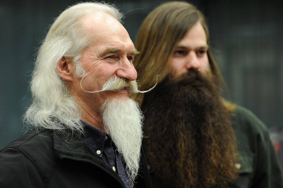 David Doering, left, winner of the moustache category, and Adam Bruck, winner of the grizzly beard and overall title, at UAA's sixth annual Beard & 'Stache Competition during the Winterfest event held in the Student Union on March 2, 2016. (Bill Roth / ADN archive 2016)