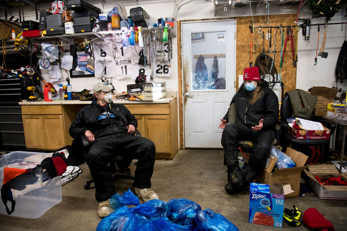 Allen Moore and Aliy Zirkle talk in the workshop of their Two Rivers kennel on Feb. 13. (Marc Lester / ADN)