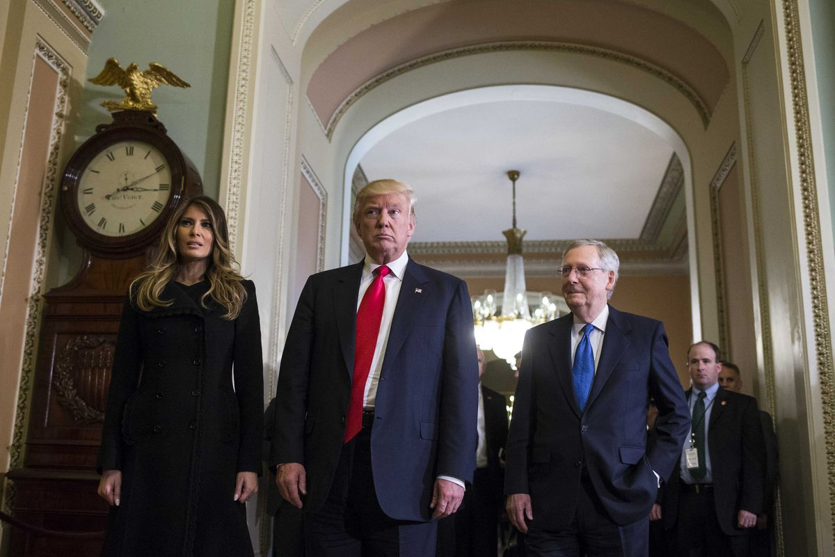 President-elect Donald Trump meets with Senate Majority Leader Mitch McConnell (R-Ky.) on Capitol Hill in Washington, Nov. 10, 2016. Melania Trump is at left. (Al Drago/The New York Times)