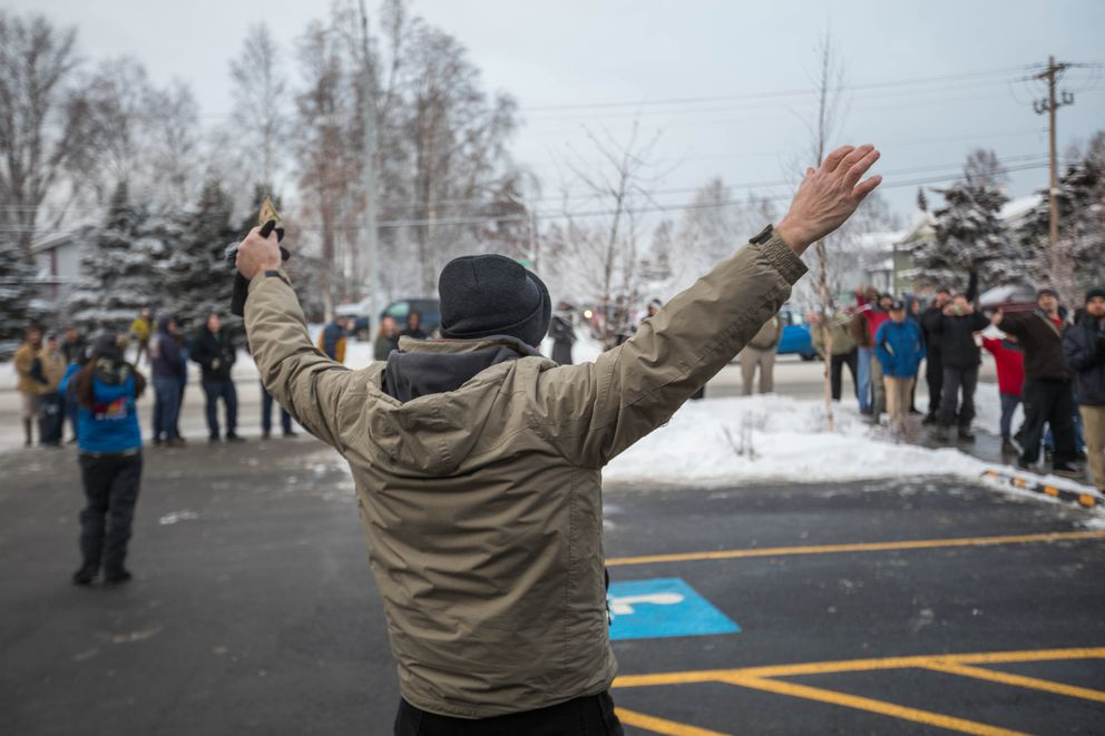 "J.D. Stinson holds his hands up in celebration after buying marijuana at Arctic Herbery on Thursday, Dec. 15, 2016. ""I feel free,"" he exclaimed. Arctic Herbery was the first legal marijuana retail store to open in Anchorage, Alaska's largest city. (Loren Holmes / Alaska Dispatch News)"