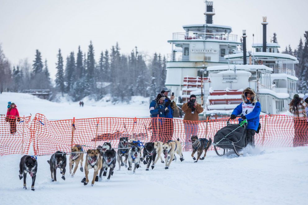 Four-time champion Martin Buser mushes past the Riverboat Discovery on the Chena River in Fairbanks during the start of the Iditarod Trail Sled Dog Race on Monday, March 9, 2015. The 1,000-mile race normally starts near Anchorage but was forced north again in 2017 due to trail problems in the Alaska Range. (Loren Holmes / Alaska Dispatch News)