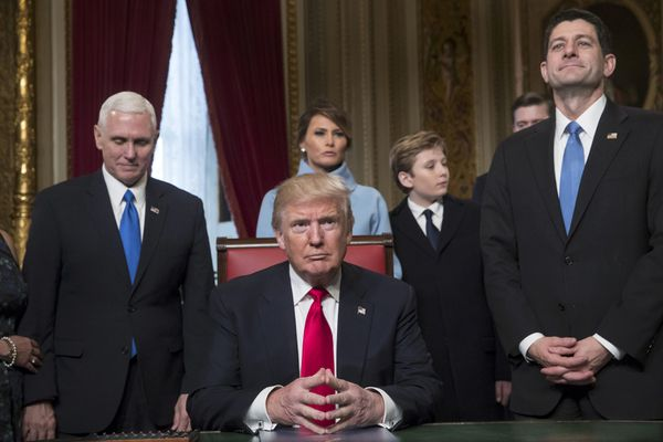 President Donald Trump is joined by the Congressional leadership and his family before formally signing his cabinet nominations into law, in the President's Room of the Senate, at the Capitol in Washington, January 20, 2017. From left are Vice President Mike Pence, the president's wife Melania Trump, their son Barron Trump, and Speaker of the House Paul Ryan, R-Wis. REUTERS/J. Scott Applewhite/Pool