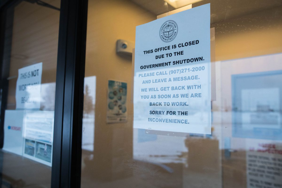 A sign on the door of the Federal Aviation Administration's Flight Standards District Office in midtown Anchorage states that they are closed due to the government shutdown on Saturday, Jan. 5, 2019. (Loren Holmes / ADN)