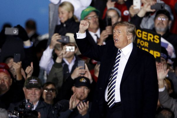 President Donald Trump waves to the crowd during a campaign rally Thursday, Nov. 1, 2018, in Columbia, Mo. (AP Photo/Charlie Riedel)