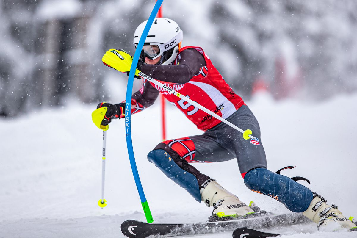 Finnigan Donley powers through a gate as snow falls Monday morning during slalom competition in the Coca-Cola Classic at Alyeska Ski Resort. (Photo by Bob Eastaugh)