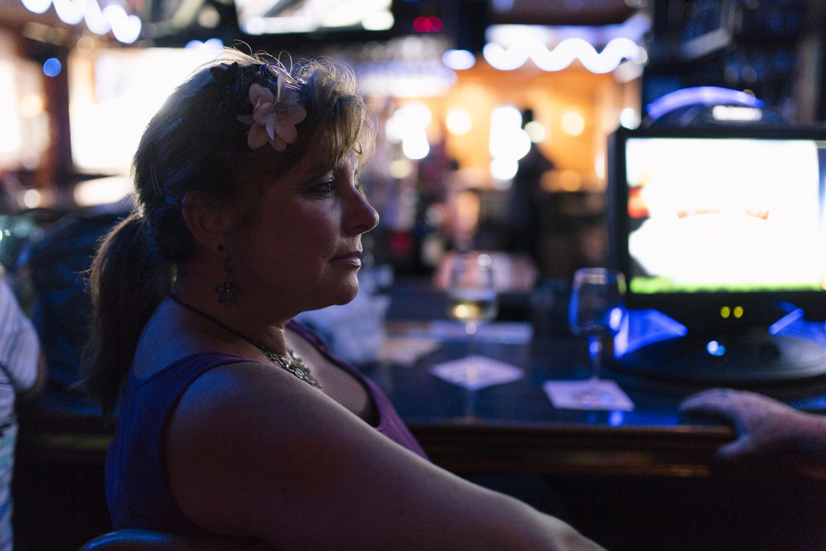 Denys Vezinau, 49, photographed at Wave's bar and restaurant in St. Clair Shores, Mich., said Donald Trump makes her nervous but that she is leaning toward him because she wants a change. Photo for The Washington Post by Nick Hagen.