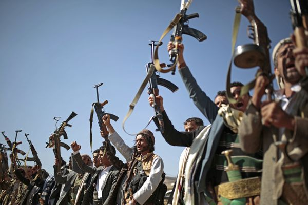 FILE - In this Dec. 13, 2018, file photo, tribesmen loyal to Houthi rebels hold up their weapons as they attend a gathering to show their support for the ongoing peace talks in Sanaa, Yemen. Asserting Congress' authority over war powers, the House is debating a resolution to force the Trump administration to withdraw U.S. troops from involvement in Yemen. It's a rebuke of the president's alliance with Saudi Arabia and prompted veto threat from the White House. (AP Photo/Hani Mohammed, File)