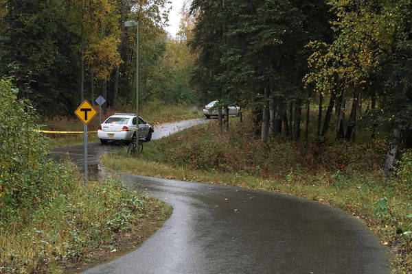 Anchorage police conduct a death investigation near the Ship Creek trail east of Reeve Blvd. Monday, Sept. 18, 2017. (Bill Roth / Alaska Dispatch News)