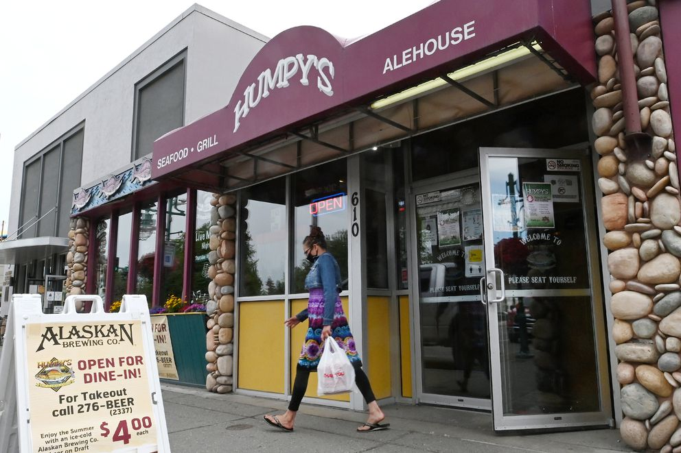 A customer picks up takeout from Humpy's on Wednesday, July 22, 2020. Mayor Ethan Berkowitz announced new capacity restrictions for bar, restaurants, gyms and other gatherings beginning at 8 a.m. on Friday. (Bill Roth / ADN)