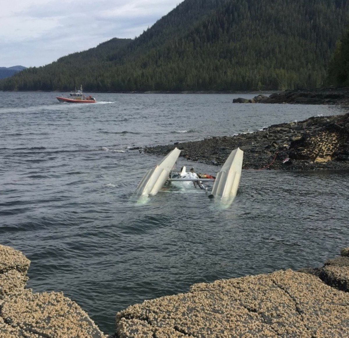 A Coast Guard Station Ketchikan 45-foot Response Boat-Medium crew searches for survivors from a downed de Havilland Beaver in George Inlet near Ketchikan, Alaska, Monday, May 13, 2019. The Beaver was involved in a midair collision. Both planes were carrying cruise passengers on flightseeing tours. (Photo courtesy Ryan Sinkey via U.S. Coast Guard)