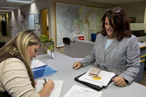 Rebecca Logan, right, filed her declaration of candidacy for mayor of Anchorage at City Hall on January 19, 2018. She's assisted by Amy Solberg in the municipal clerk's office. (Marc Lester / ADN)