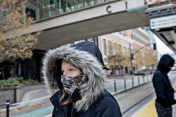 Maddy Snow waits for a TRAX train on a platform in downtown Salt Lake City on Nov. 9, 2020. MUST CREDIT: Photo for The Washington Post by Kim Raff