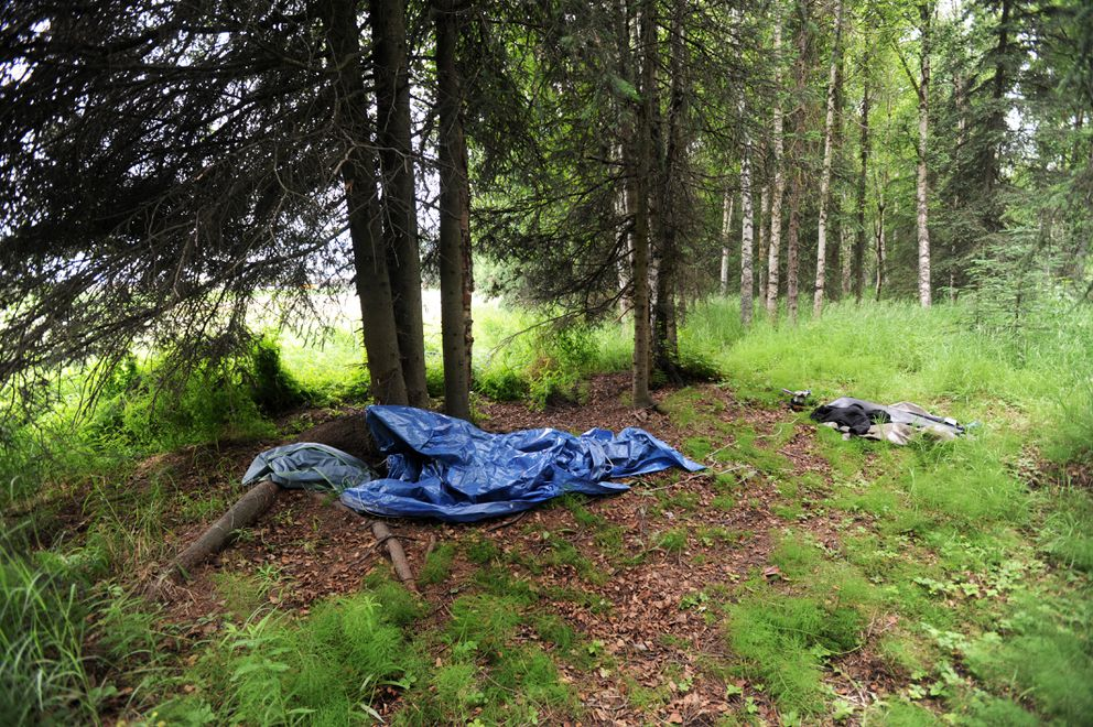Homeless camps border Centennial Park Campground on Wednesday in Centennial Park in Muldoon. Food and trash in such a camp attracted a black bear to a tent Tuesday morning, according to Anchorage Police. (Erik Hill / Alaska Dispatch News)