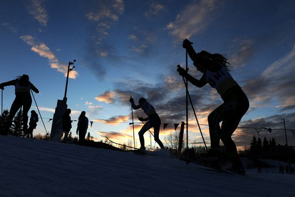 B Team skiers Ava Straub, of Colony High, Laura Ripp, of Eagle River High, and Page Ripley, of Colony High, climb a small hill during the Bartlett High 2x2x2 Sprint Relay freestyle cross-country ski races at Kincaid Park in Anchorage, Alaska on Wednesday, Jan. 17, 2018. (Bob Hallinen / ADN)
