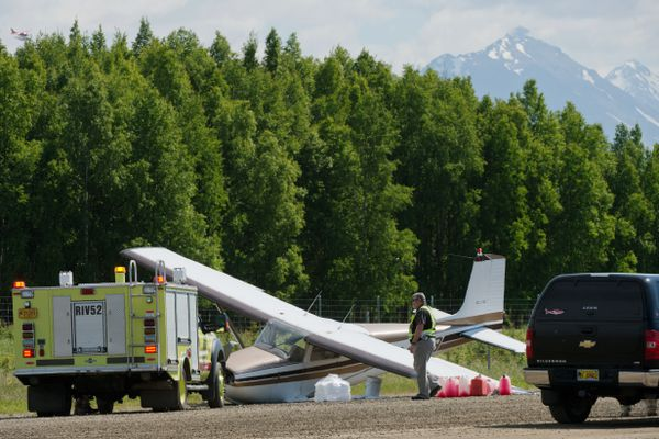 Emergency crews respond to a damaged aircraft at the Lake Hood airstrip on June 13, 2018. A spokesman for the National Transportation Safety Board said the plane was involved in a midair collision near the mouth of the Susitna River. (Marc Lester / Anchorage Daily News)