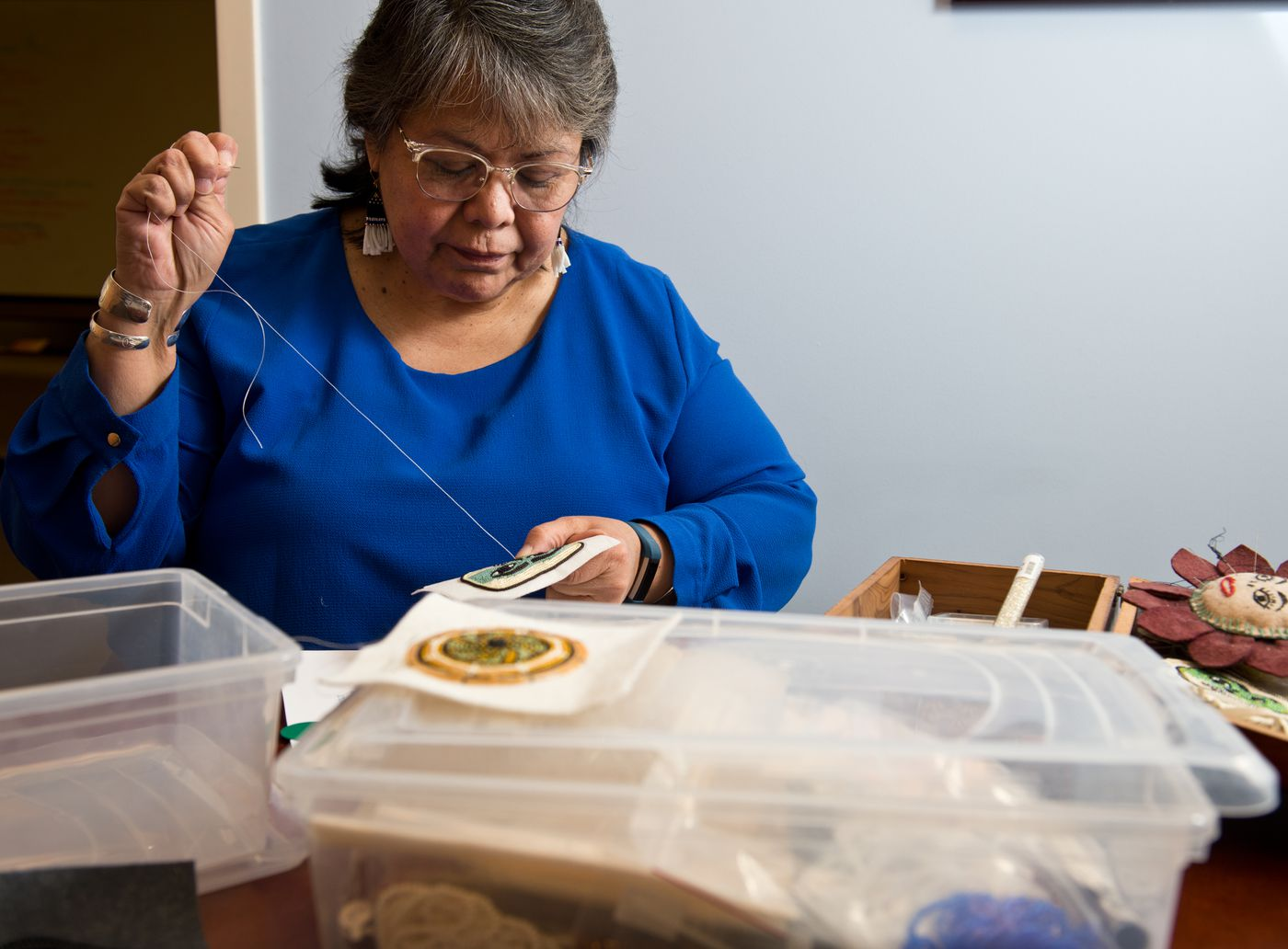 Laura Revels hopes to grow her Anaaski Kawoot business to market Alaska Native beadwork for several artists. (Marc Lester / ADN)