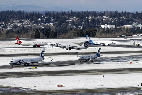 An Alaska Airlines plane takes off above arriving flights waiting for gate assignments, Tuesday, Feb. 5, 2019, at Seattle-Tacoma International Airport in Seattle. There were still some delays at the airport the day after winter weather pounded a swath of the U.S. West on Monday, closing schools and delaying flights in coastal cities like Seattle that rarely get much snow. (AP Photo/Ted S. Warren)