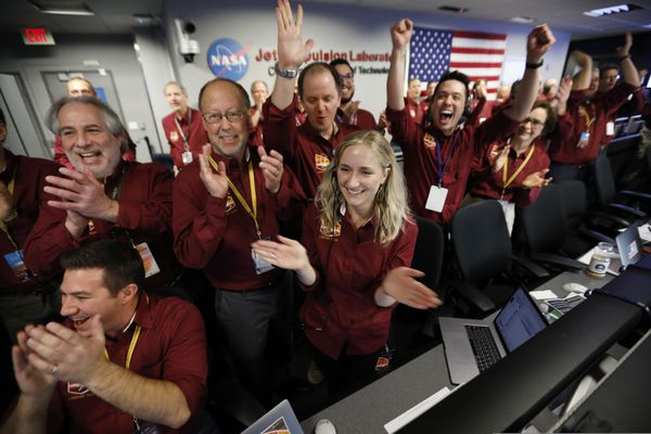 Engineers celebrate as the InSight lander touch downs on Mars in the mission support area of the space flight operation facility at NASA's Jet Propulsion Laboratory Monday, Nov. 26, 2018, in Pasadena, Calif. (AP Photo/(Al Seib /Los Angeles Times via AP, Pool)