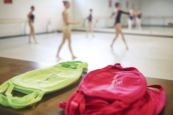Stacks of fabric face masks rest at the back of the room as ballet practice takes place at Alaska Dance Theatre in Anchorage on July 20, 2020. (Emily Mesner / ADN)