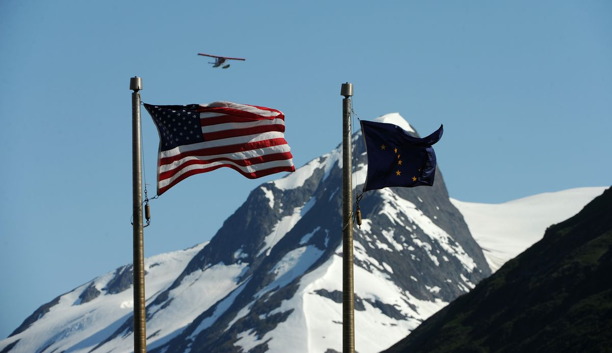 The U.S. and Alaska flags at the Begich Boggs Visitor Center at Portage, south of Anchorage. (Bob Hallinen / ADN archive)