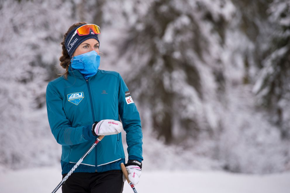 Rosie Brennan listens to coach Erik Flora at the start of a training session. APU Nordic Ski Center's University Elite Team trained at the Hillside Ski Trails on November 9, 2020. (Marc Lester / ADN)