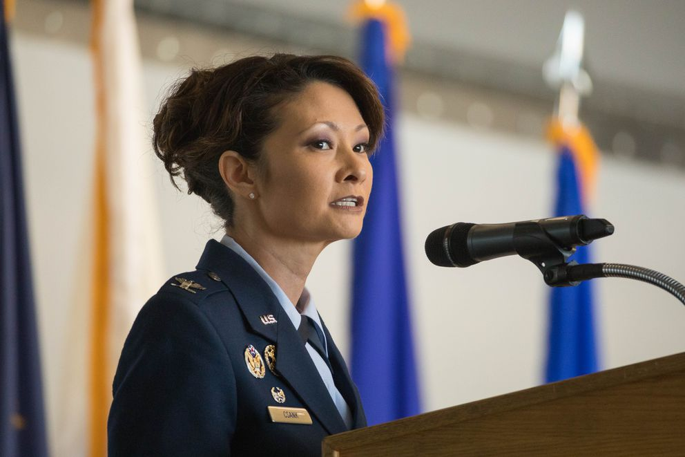 Col. Patricia Csànk speaks after assuming command of the 673d Air Base Wing Friday at JBER. (Loren Holmes / ADN)