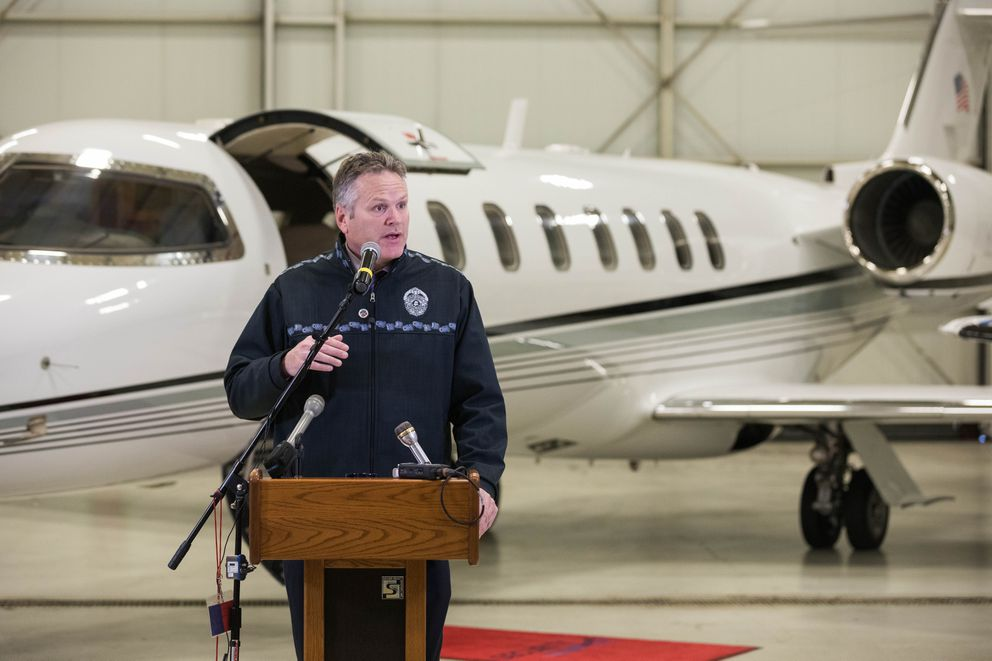 Governor-elect Mike Dunleavy announces new members of his transition team Friday, Nov. 9, 2018 at Security Aviation. Behind Mr. Dunleavy is a Lear 45 charter jet, owned by Security Aviation. (Loren Holmes / ADN)