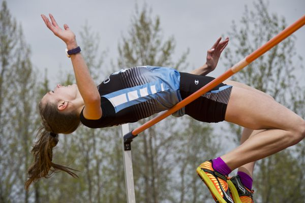 Emma Nelson of Chugiak makes an attempt at a region record after winning the high jump event. She sucessfully cleared the bar at 5'5