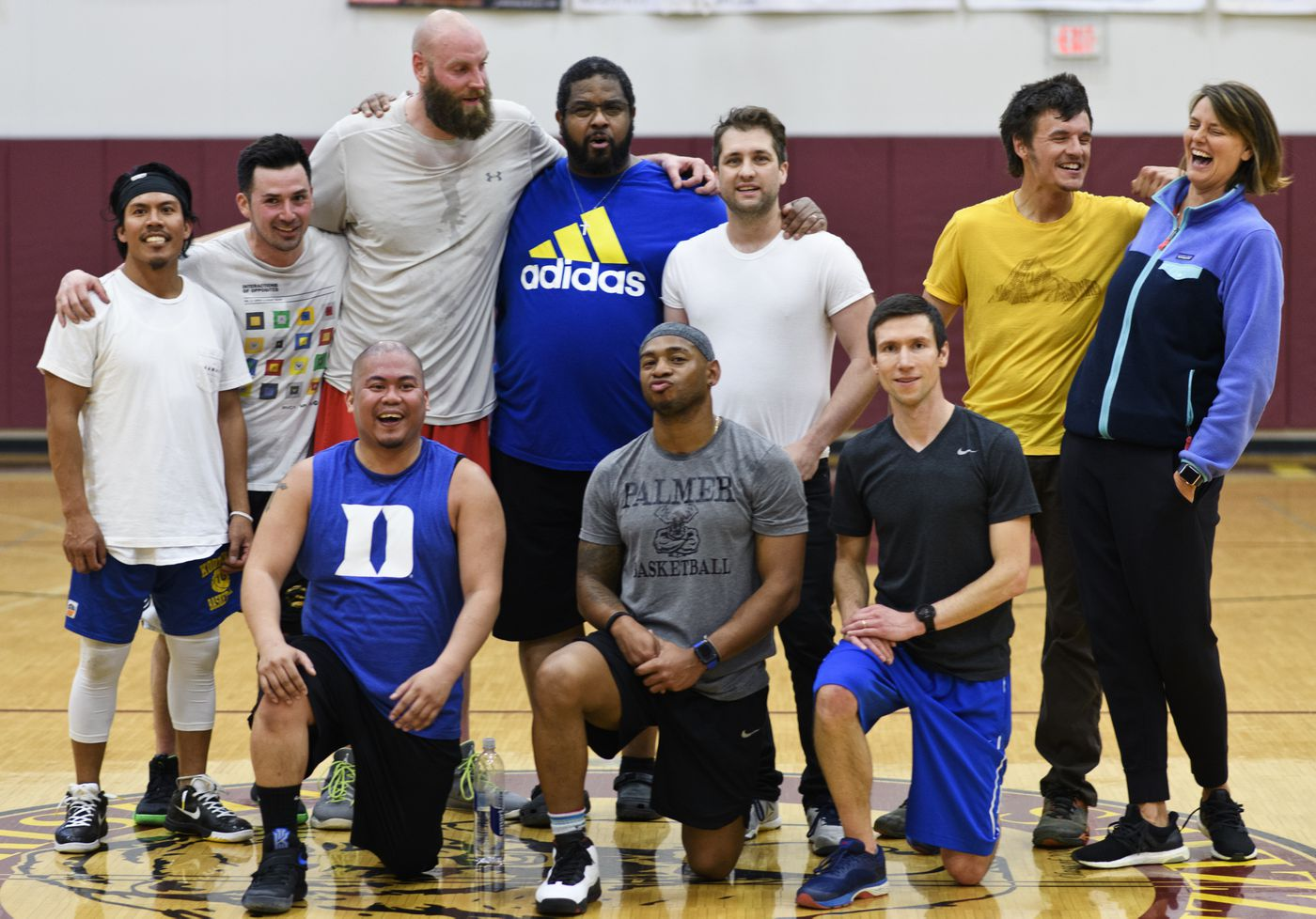 Players and coaches of the 2001 Kodiak High School boys varsity basketball team gathered for a pickup basketball game in Anchorage on April 25, 2019. Their high school state championship game was inducted into the Alaska Sports Hall of Fame this year. (Marc Lester / ADN)