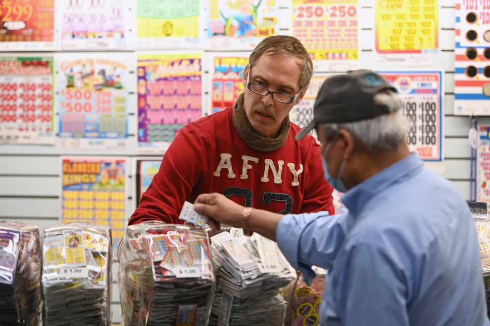 Jon Fischer assists a customer at Lynn's Pulltabs in the Northway Mall on Thursday, August 27, 2020. Fischer said the business has been in the mall over 20 years. (Bill Roth / ADN)