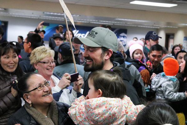 Musher Pete Kaiser greets fans at the Alaska Airlines terminal on March 18, 2019 in Bethel after returning home from winning the 2019 Iditarod Trail Sled Dog Race. (Gabby Salgado / KYUK)