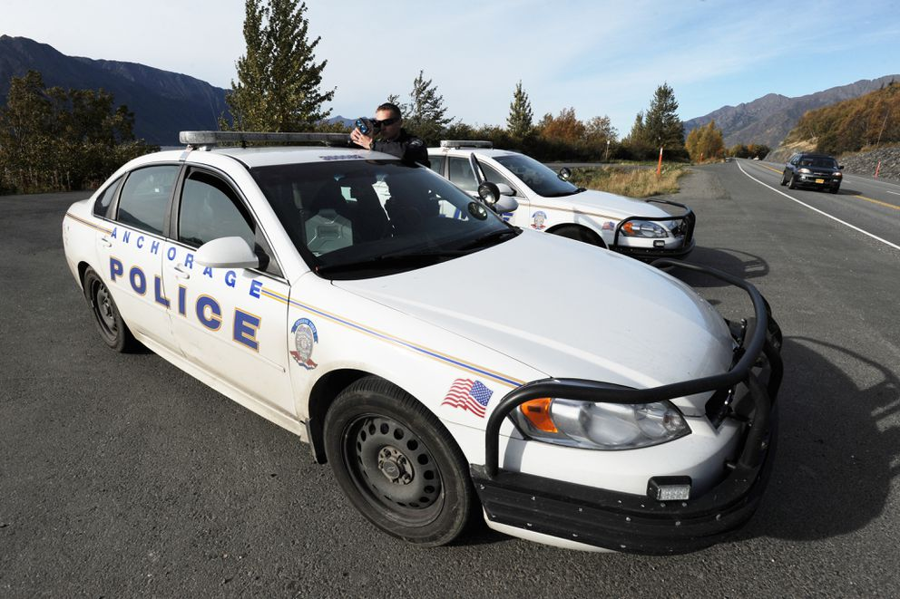 Anchorage Police Department officer Nick Ward operates a laser radar at Mile 99 of the Seward Highway on Oct. 1, 2017. (Bill Roth / ADN archive)