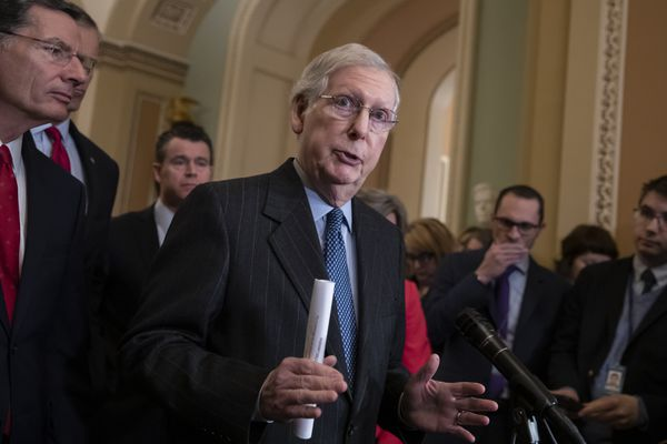 Senate Majority Leader Mitch McConnell, R-Ky., joined at left by Sen. John Barrasso, R-Wyo., and Sen. Todd Young, R-Ind., speaks to reporters asking about the threat of another government shutdown following their weekly strategy meeting, at the Capitol in Washington, Tuesday, Jan. 29, 2019. With the government funded for three weeks, it's up to a group of House and Senate negotiators to avoid another closure. (AP Photo/J. Scott Applewhite)