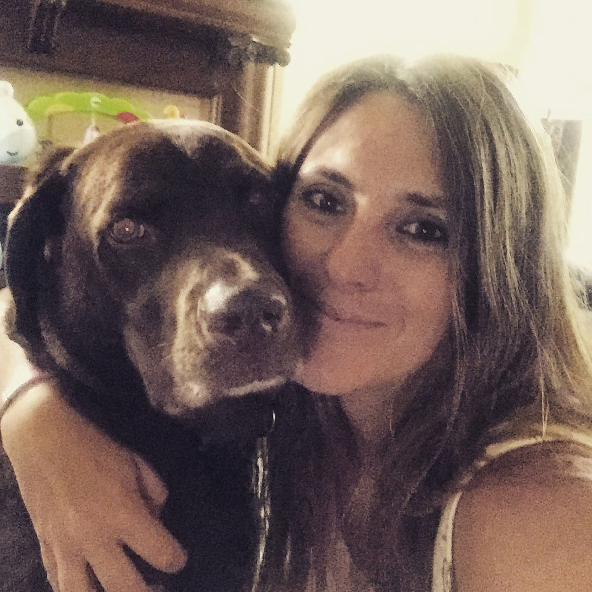 Lisa McCombs says she was barred from boarding multiple American Airlines flights because she was traveling with her service dog, Jake. (Photo courtesyLisa McCombs)