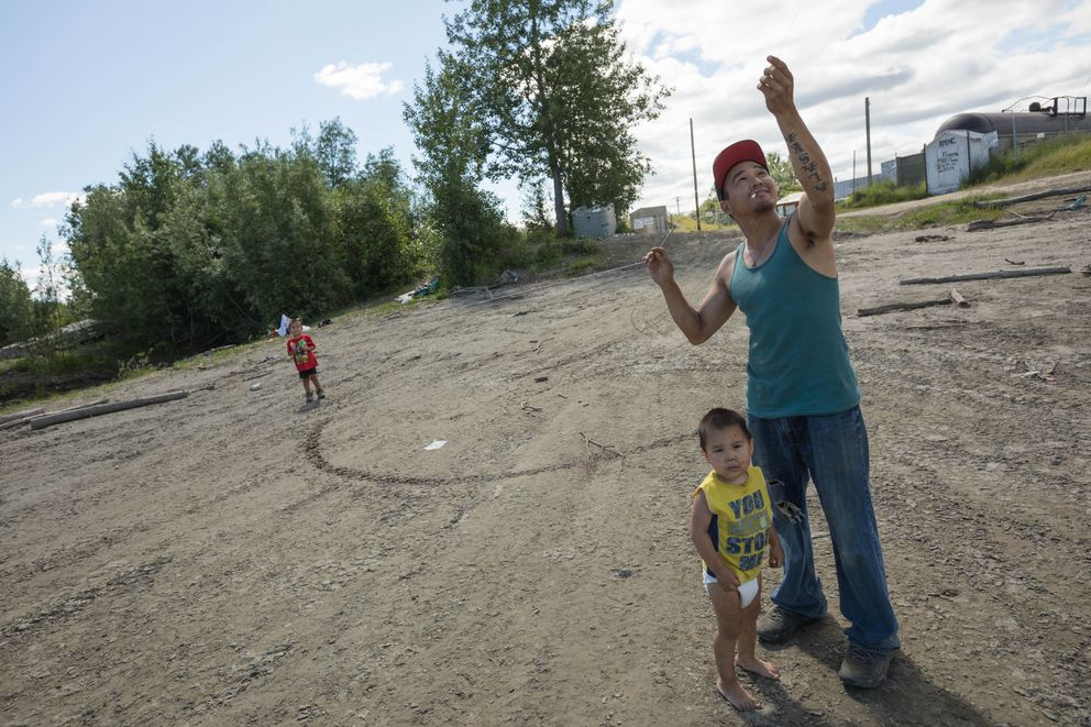 Pete Stephanoff flies a kite with his children Pete, 4, and Colt, 2. (Loren Holmes / ADN)