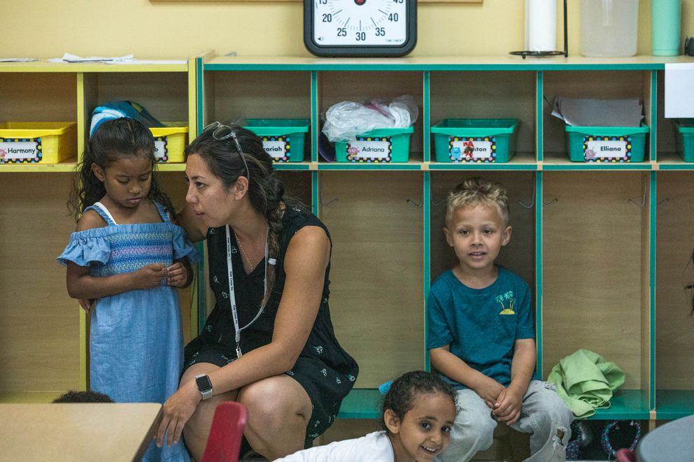 Teacher Nicole Lezama talks with children at a Kids' Corps, Inc. Pre-K program Tuesday, July 9, 2019 in Anchorage. (Loren Holmes / ADN)