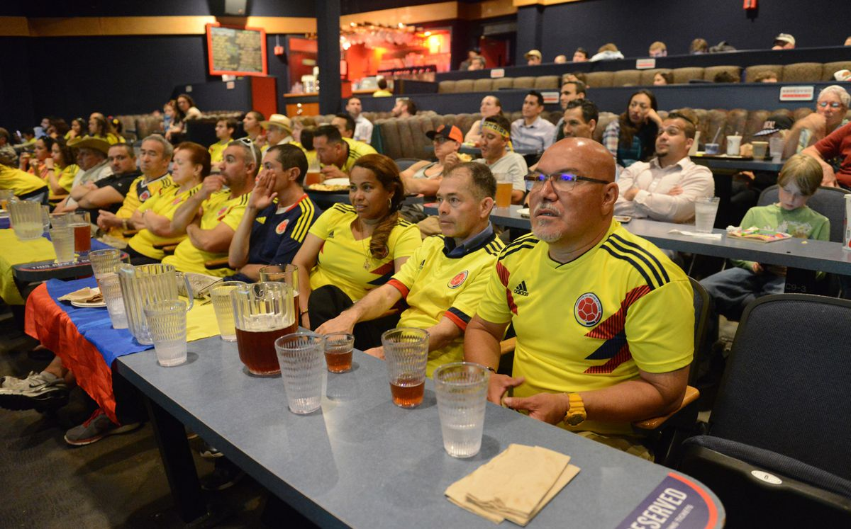 Alirio Rojas, at right, and other Colombia fans watch the Colombia vs. England World Cup Soccer match at the Bear Tooth Theatrepub. (Bob Hallinen / ADN)