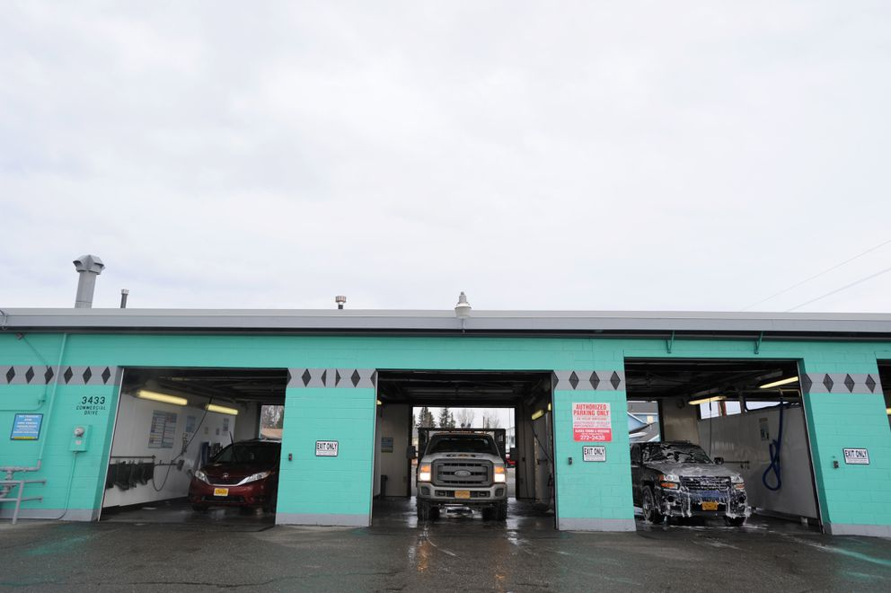 Vehicles get clean at the Mountain View Car Wash on Thursday. (Anne Raup / ADN)