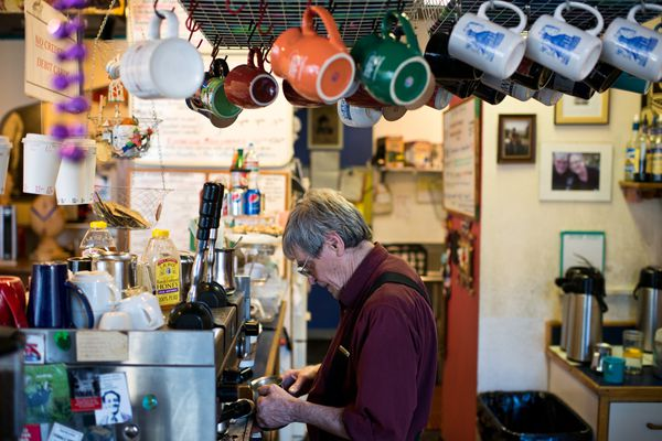 George Gee makes a drink for a customer atSide Street Espresso. (Marc Lester / ADN)