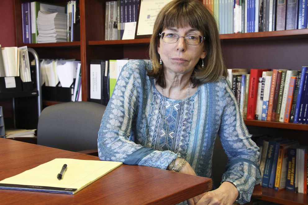 In this Tuesday, July 3, 2018 photo, Margaret Stock, an Alaska-based immigration attorney and a retired Army Reserve lieutenant colonel who helped create the immigrant recruitment program, poses at her office in Anchorage. Stock said she's been inundated over the past several days by recruits who report being abruptly discharged. (AP Photo/Mark Thiessen)
