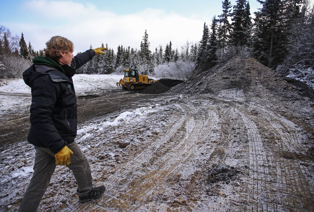 UAA ski coach Sparky Anderson checks out the construction of a new slalom run at Hilltop Ski Area. (Emily Mesner / ADN)