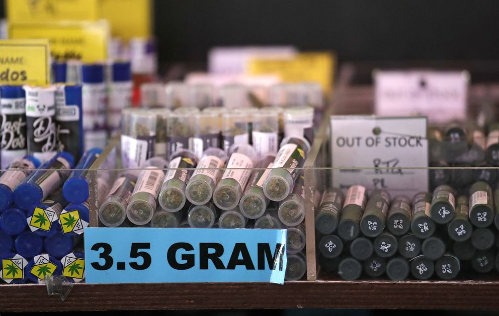 In this photo taken Thursday, March 28, 2019, pot products line a display case at a marijuana shop in Seattle. When Washington and Colorado launched their pioneering marijuana industries in the face of U.S. government prohibition, they imposed strict rules in hopes of keeping the U.S. Justice Department at bay. Five years later, federal authorities have stayed away, but the industry says it has been stifled by over-regulation. Lawmakers in both states have heard the complaints and are moving to ease the rules. (AP Photo/Elaine Thompson)
