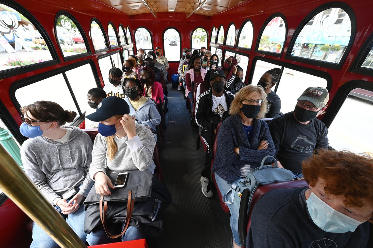 A trolley full of tourists prepare to depart from Fourth Avenue in downtown with Anchorage Trolley Tours on Thursday, June 17, 2021. (Bill Roth / ADN)
